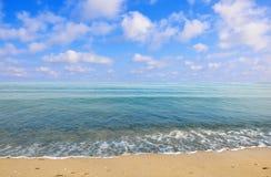 Black sea beach blue sky sand sun daylight Royalty Free Stock Photo