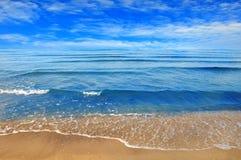 Black sea beach blue sky sand sun daylight Royalty Free Stock Photography
