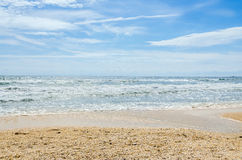 The Black Sea beach, sand, blue sky, clouds. Royalty Free Stock Image