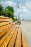 The Black Sea beach, seaside (seafront) with colored benches and lighting poles Stock Photos