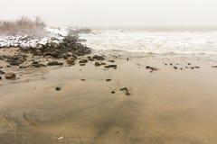 Black Sea beach during a snowfall in Bulgaria, winter, december Stock Image