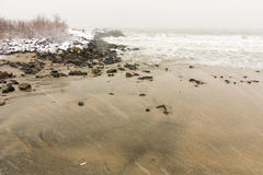 Black Sea beach during a snowfall in Bulgaria, winter Stock Photography