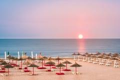 Black Sea beach with straw umbrellas Stock Images
