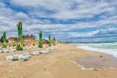 Black Sea beach in a windy day, terrace with umbrellas Stock Photos