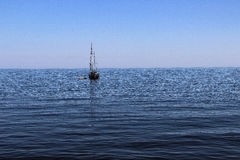 Black sea, blue, Crimea, nature, no people, boat, boat, summer, sea, sky. A yacht in the black sea, on a blue background, summer Royalty Free Stock Image