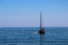 Black sea, blue, Crimea, nature, no people, boat, boat, summer, sea, sky. A yacht in the black sea, on a blue background, summer Royalty Free Stock Photo