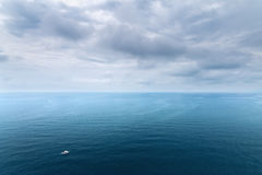 Black sea boat on the waves Stock Image