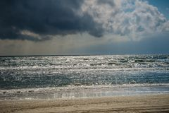 Black Sea on a cloudy day. Sea and sand royalty free stock images