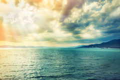 The Black Sea coast. Black Sea in Russia through the clouds illuminated by the sun Stock Image