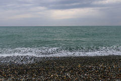 The Black sea coast. In cloudy weather, Sochi, Russia royalty free stock photos