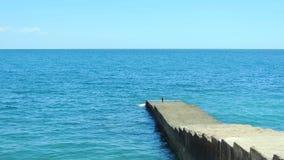 Black sea. The black sea coast of the Crimea and the breakwater. Sea horizon. Southern coast of Crimea. Summer daily seascape Stock Photography