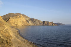 Black Sea coast of Crimea. Seashore in the evening sunlight, Crimea, Ukraine Royalty Free Stock Photo