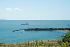 Black sea coast in Crimea, ship and fortress Royalty Free Stock Image