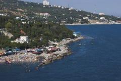 The Black Sea coast of Crimea. Simeiz. SIMEIZ, UKRAINE - AUGUST 11, 2011: Rocky beaches on August 11, 2011 in the Crimea Simeiz. Simeiz  - one of the most Stock Image