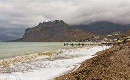 The Black sea coast in a small storm.Koktebel. Royalty Free Stock Photos