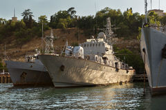 Black Sea Fleet warships are on the quay of the Sevastopol Bay. Royalty Free Stock Photography