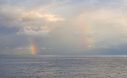 Black Sea landscape with two vertical rainbows Royalty Free Stock Image