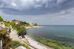 Black sea on old town background. Royalty Free Stock Photo