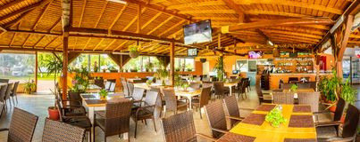 Black Sea resort restaurant and bar. Indoor panorama of rustic restaurant and bar in a Black Sea resort stock photos