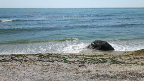 Black sea. A rock and the waves of the black sea in Eforie Sud, Romania Stock Images