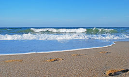 Black sea and sand Royalty Free Stock Image