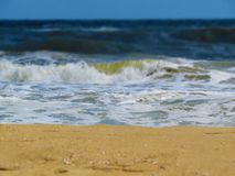 Black sea sands and stormy waves. Summer vacation. Stock Photo