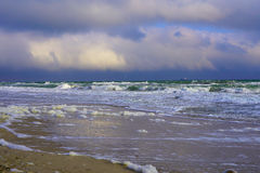 Black Sea Seaside with Reflection. Waves and clouds. Sand and sea foam and clouds reflection. North sealine Royalty Free Stock Photography
