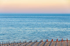 The Black Sea shore from Albena, Bulgaria with golden sands. Blue fresh water, sunbeds and umbrellas at sunset Stock Photo