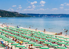 The Black Sea shore, blue clear water, beach with sand, Albena, Bulgaria Royalty Free Stock Image