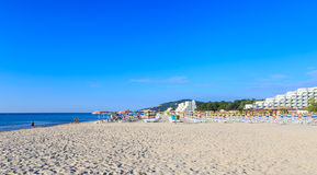 The Black Sea shore, blue clear water, beach with sand, Albena, Bulgaria Stock Photos