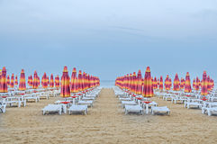The Black Sea shore. blue sea water, clouds sunset sky, beach sand with umbrellas and sunbeds Stock Photography