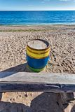 Colored barrel and wooden bench Stock Image