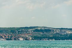The Black Sea shore, green hills with houses, blue clouds sky Royalty Free Stock Images