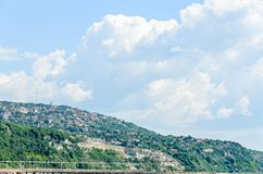 The Black Sea shore, green hills with houses, blue clouds sky Stock Images
