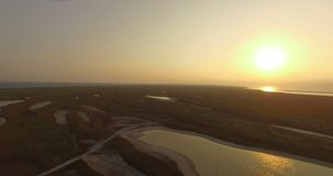 The Black Sea Shore With Patches of Brownish Wetland at a Splendid Sunset. An Aerial Shot of the Black Sea Shore Covered With a Lot of Brownish Wetland and stock video