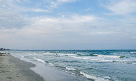 The Black Sea shore, sea side with sand, water and sky Royalty Free Stock Image