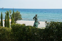 Black sea shore with statue Stock Images