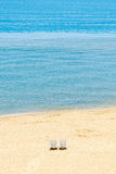The Black Sea shore, two sun beds seaside and beach with gold sa Stock Photography