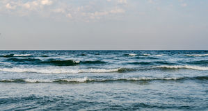 The Black Sea shore, water waves, blue sky Royalty Free Stock Photo