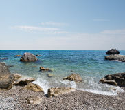 Black sea and stony beach Stock Photo