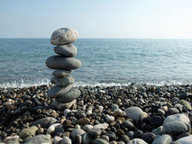 Black sea, sun and pebbles Royalty Free Stock Photography