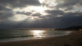 Black Sea - Sun rays at sea. A beautiful marine landscape that produces sunsets strewn through the clouds royalty free stock photo