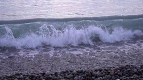 Black sea waves, Kvariati beach on a beautiful sunset stock footage