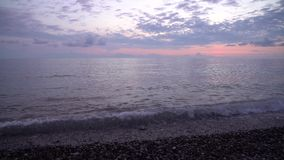 Black sea waves, Kvariati beach on a beautiful sunset stock video footage