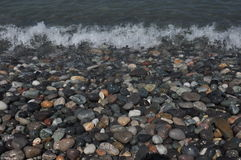 Black Sea. Waves washing down rocky beach Stock Images