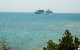 Black sea and white motor ship Stock Photo
