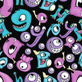 Black seamless background with little monsters. Stock Photos