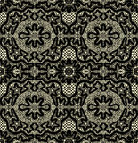 Black seamless lace on a yellow background Royalty Free Stock Photography