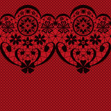 Black seamless lacy lace pattern texture on red. Background Royalty Free Stock Image