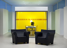 Black seats. In a colorful room with computer-screen Royalty Free Stock Images